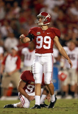 TUSCALOOSA, AL - SEPTEMBER 22: Leigh Tiffin #99 of the Alabama Crimson Tide follows his field goal kick against the Georgia Bulldogs at Bryant-Denny Stadium September 22, 2007 in Tuscaloosa, Alabama. Georgia defeated Alabama 26-23 in overtime. (Photo by D
