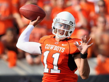 STILLWATER, OK - SEPTEMBER 05:  Quarterback Zac Robinson #11 of the Oklahoma State Cowboys throws a pass during the college football game against the Georgia Bulldogs at Boone Pickens Stadium on September 5, 2009 in Stillwater, Oklahoma.  The Cowboys defe