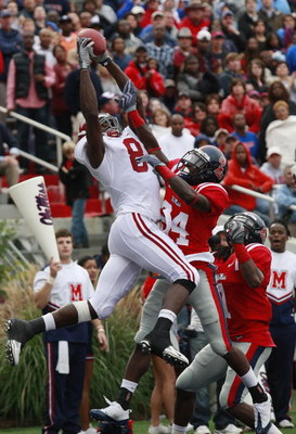 OXFORD, MS - OCTOBER 10:  Julio Jones #8 of the Alabama Crimson Tide has his reception broken up by Kendrick Lewis #1 and Cassius Vaughn #24 of the Mississippi Rebels during their college football game at Vaught-Hemingway Stadium on October 10, 2009 in Ox