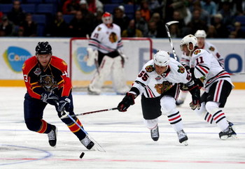 HELSINKI, FINLAND - OCTOBER 03:  #55 Ben Eager of the Chicago Blackhawks tries to tackle #43 Dmitry Kulikov of the Florida Panthers during The Compuware/NHL Premiere Helsinki series match between the Chicago Blackhawks and the Florida Panthers at the Hart