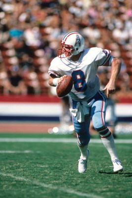 LOS ANGELES - NOVEMBER 11:  Quaterback Archie Manning #8 of the Houston Oilers rolls out to pass during the game against the Los Angeles Raiders at the Los Angeles Memorial Coliseum on November 11, 1983 in Los Angeles, California.  The Raiders won 20-6.