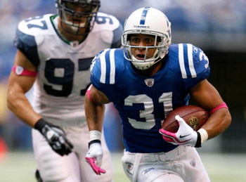 INDIANAPOLIS - OCTOBER 04:  Donald Brown #31 of the Indianapolis Colts runs with the ball during the NFL game against the Seattle Seahawks at Lucas Oil Stadium on October 4, 2009 in Indianapolis, Indiana. The Colts won 34-17.  (Photo by Andy Lyons/Getty I