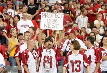 GLENDALE, AZ - OCTOBER 11: A fan of the Arizona Cardinals hold up a sign reading 'protect our nest' during the NFL game against the Houston Texans at the Universtity of Phoenix Stadium on October 11, 2009 in Glendale, Arizona. (Photo by Christian Petersen