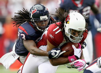GLENDALE, AZ - OCTOBER 11:   Cornerback Dunta Robinson #23 of the Houston Texans tackles Larry Fitzgerald #11 of the Arizona Cardinals during the NFL game at the Universtity of Phoenix Stadium on October 11, 2009 in Glendale, Arizona. The Cardinals defeat
