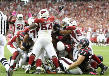 GLENDALE, AZ - OCTOBER 11: Linebacker Gerald Hayes #54 of the Arizona Cardinals signals for a turnover after the Houston Texans were stopped on a fourth and goal during the final moments of the NFL game at the Universtity of Phoenix Stadium on October 11,