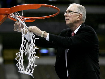DENVER - MARCH 11:  Head coach Steve Fisher of the San Diego State University Aztecs cuts down the net after defeating the Wyoming Cowboys 69-64 in the championship of the Mountain West Conference Basketball Tournament on March 11, 2006 at the Pepsi Cente