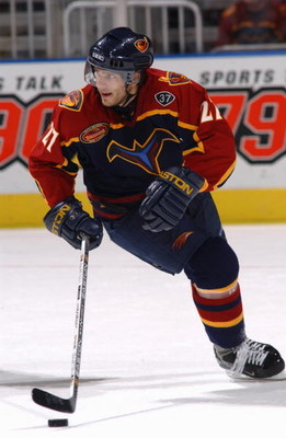 ATLANTA - OCTOBER 18:  Center Patrik Stefan #27 of the Atlanta Thrashers controls the puck during the game against the Chicago Blackhawks at Philips Arena on October 18, 2003 in Atlanta, Georgia.  The Thrashers defeated the Blackhawks 7-2.  (Photo by Scot