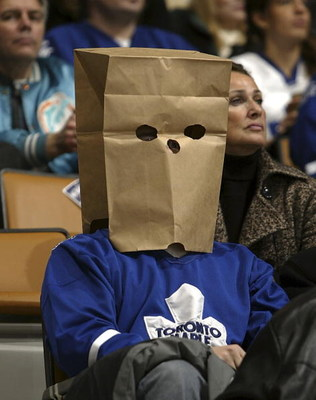 TORONTO - DECEMBER 23:  A Toronto Maple Leafs fan sits in the stands as the Washington Capitals take on the Toronto Maple Leafs in their NHL game at the Air Canada Centre December 23, 2006 in Toronto, Ontario. The Capitals beat the Maple Leafs 3-2.  (Phot