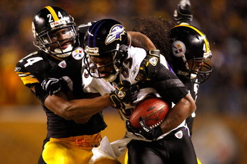 PITTSBURGH - JANUARY 18:  Ike Taylor #24 and Troy Polamalu #43 of the Pittsburgh Steelers tackle Derrick Mason #85 of the Baltimore Ravens during the AFC Championship game on January 18, 2009 at Heinz Field in Pittsburgh, Pennsylvania.  (Photo by Streeter