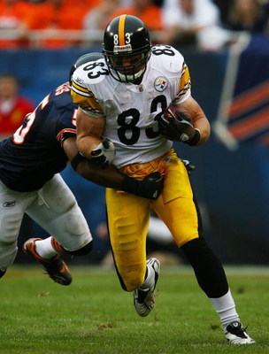 CHICAGO - SEPTEMBER 20: Heath Miller #83 of the Pittsburgh Steelers slips past Lance Briggs #55 of the Chicago Bears on September 20, 2009 at Soldier Field in Chicago, Illinois. The Bears defeated the Steelers 17-14. (Photo by Jonathan Daniel/Getty Images