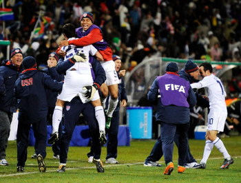 BLOEMFONTEIN, SOUTH AFRICA - JUNE 24:  Benny Feilhaber #22, Charlie Davies #9 and Landon Donovan #10 of USA celebrate with their teammates on the sideline after a goal by Clint Dempsey #8 against Spain during the FIFA Confederations Cup Semi Final match b