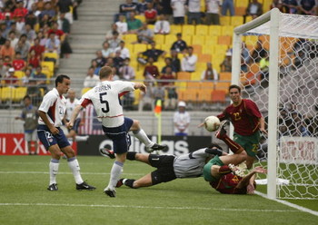 SUWON - JUNE 5:  John O'Brien of the USA scores the opening goal during the first half of the Portugal v USA, Group D, World Cup Group Stage match played at the Suwon World Cup Stadium, Suwon, South Korea on June 5, 2002. USA won the match 3 - 2. (Photo b