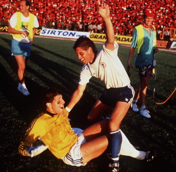 OCT 1989:  TONY MEOLA (ON FLOOR) AND JOHN HARKES OF THE US NATIONAL SOCCER CELEBRATE AFTER DEFEATING TRINIDAD AND TOBAGO 1-0 TO QUALIFY FOR THE 1990 WORLD CUP FINALS. Mandatory Credit: RUSSELL CHEYNE/ALLSPORT