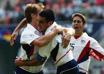 JEONJU - JUNE 17:  Brian McBride of the USA celebrates his goal with team mate Claudio Reyna during the Mexico v USA, World Cup Second Round match played at the Jeonju World Cup Stadium, Jeonju, South Korea on June 17, 2002. The USA won 2-0. (Photo by Chu