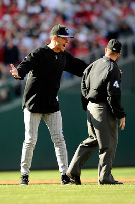 PHILADELPHIA - OCTOBER 07:  Manager Jim Tracy (L) of the Colorado Rockies argues with second base umpire Jerry Meals after he felt Cliff Lee #34 of the Philadelphia Phillies should of been called out on a pickoff attempt at second base in the bottom of th