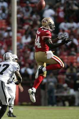 SAN FRANCISCO - AUGUST 22:   San Francisco 49ers wide receiver Josh Morgan #84 goes up for the ball as Oakland Raiders cornerback Chris Johnson #37 defends during the 1st quarter as the San Francisco 49ers host the Oakland Raiders at Candlestick Park Augu