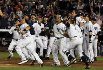 NEW YORK - OCTOBER 09:  The New York Yankees celebrate Mark Teixeira's (not pictured) walk off home run in the eleventh inning against the Minnesota Twins in Game Two of the ALDS during the 2009 MLB Playoffs at Yankee Stadium on October 9, 2009 in the Bro
