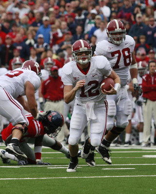 OXFORD, MS - OCTOBER 10:  Quarterback Greg McElroy #12 of the Alabama Crimson Tide runs for yardage during their game against the Mississippi Rebels at Vaught-Hemingway Stadium on October 10, 2009 in Oxford, Mississippi. (Photo by Dave Martin/Getty Images