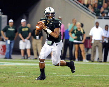 TAMPA, FL - OCTOBER 15: Quarterback B.J. Daniels #7 of the University of South Florida Bulls looks to pass against the Cincinnati Bearcats October 15, 2009 at Raymond James Stadium in Tampa, Florida.  (Photo by Al Messerschmidt/Getty Images)