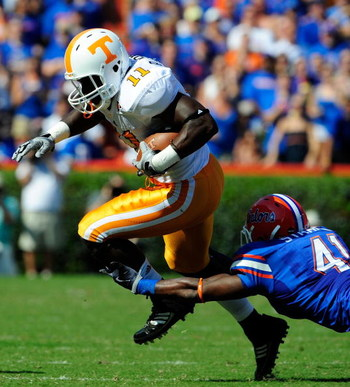 GAINESVILLE, FL - SEPTEMBER 19:  Bryce Brown #11 of the Tennessee Volunteers is tackled by Ryan Stamper #41 of the Florida Gators during the game at Ben Hill Griffin Stadium on September 19, 2009 in Gainesville, Florida.  (Photo by Sam Greenwood/Getty Ima