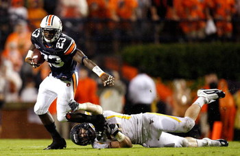 AUBURN, AL - SEPTEMBER 19:  Onterio McCalebb #23 of the Auburn Tigers breaks a tackle by Pat Lazear #31 of the West Virginia Mountaineers at Jordan-Hare Stadium on September 19, 2009 in Auburn, Alabama.  (Photo by Kevin C. Cox/Getty Images)
