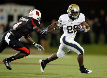 LOUISVILLE, KY - OCTOBER 02:  Dion Lewis #28 of the Pittsburgh Panthers runs with the ball  while defended by Chaz Thompson #4 of the Louisville Cardinals during the Big East Conference game at Papa John's Cardinal Stadium on October 2, 2009 in Louisville