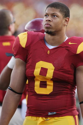 PASADENA, CA - DECEMBER 6:  Nick Perry #8 of the USC Trojans walks on the sideline against the UCLA Bruins on December 6, 2008 at the Rose Bowl in Pasadena, California.  USC won 28-7.  (Photo by Jeff Golden/Getty Images)