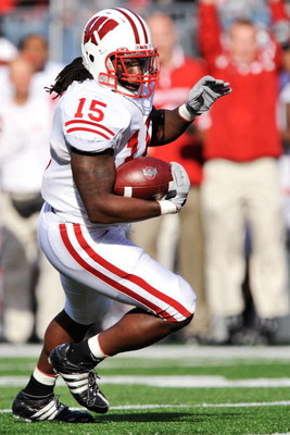 COLUMBUS, OH - OCTOBER 10:  Linebacker Culmer St. Jean#15 of the Wisconsin Badgers runs with the ball against the Ohio State Buckeyes at Ohio Stadium on October 10, 2009 in Columbus, Ohio.  (Photo by Jamie Sabau/Getty Images)