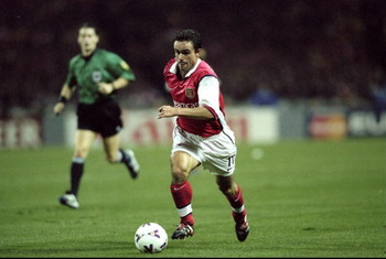 27 Oct 1999:  Marc Overmars of Arsenal in action during the UEFA European Champions League Group B match against Fiorentina played at Wembley Stadium, London. The game finished in a 1-0 away win for Fiorentina and saw the elimination of Arsenal from these