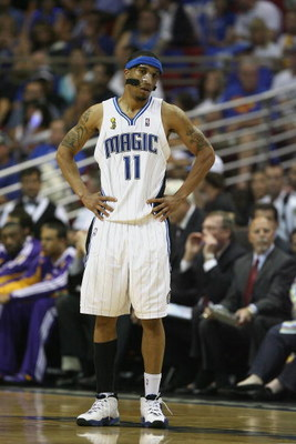 ORLANDO, FL - JUNE 14:  Courtney Lee #11 of the Orlando Magic stands on the court during Game Five of the 2009 NBA Finals against the Los Angeles Lakers on June 14, 2009 at Amway Arena in Orlando, Florida. The Lakers won 99-86. NOTE TO USER:  User express