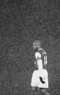 BLACKBURN, UNITED KINGDOM - JANUARY 13: Thierry Henry of Arsenal looks on  in the rain during the Barclays Premiership match between Blackburn Rovers and Arsenal at Ewood Park on January 13, 2007 in Blackburn, England. (Photo by Laurence Griffiths/Getty I