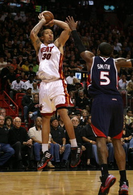MIAMI - APRIL 27:  Michael Beasley #30 of the Miami Heat shoots over Josh Smith #5 of the Atlanta Hawks during Game Four of the Eastern Conference Quarterfinals of the 2009 NBA Playoffs at American Airlines Arena on April 27, 2009 in Miami, Florida. NOTE