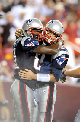 LANDOVER, MD - AUGUST 28:  Tom Brady #12 and Randy Moss #81 of the New England Patriots celebrate after scoring a touchdown in the second quarter of a preseason game against the Washington Redskins at FedExField on August 28, 2009 in Landover, Maryland.