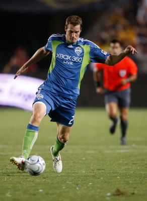 CARSON, CA - AUGUST 15:  Nate Jaqua #21 of the Seattle Sounders FC runs with the ball against the Los Angeles Galaxy at the Home Depot Center on August 15, 2009 in Carson, California. Sounders FC defeated the Galaxy 2-0.  (Photo by Jeff Gross/Getty Images