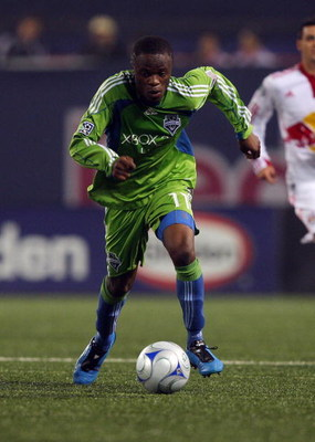 EAST RUTHERFORD, NJ - JUNE 20:  Steve Zakuani #11 of the Seattle Sounders FC plays the ball against the New York Red Bulls at Giants Stadium in the Meadowlands on June 20, 2009 in East Rutherford, New Jersey.  (Photo by Mike Stobe/Getty Images for New Yor