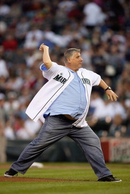 SEATTLE - SEPTEMBER 18:  Head coach Sigi Schmid of the Seattle Sounders throws out the first pitch prior to the game between the Seattle Mariners and the New York Yankees on September 18, 2009 at Safeco Field in Seattle, Washington. (Photo by Otto Greule