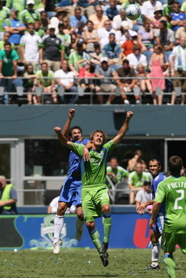 SEATTLE - JULY 18:  Roger Levesque of Seattle Sounders FC goes up for the header against Juliano Belletti #35 of Chelsea FC during the game on July 18, 2009 at Qwest Field in Seattle, Washington. (Photo by Otto Greule Jr/Getty Images)