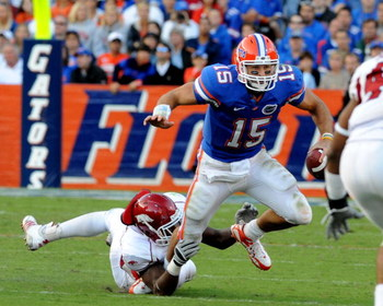 GAINESVILLE, FL - OCTOBER 17: Quarterback Tim Tebow #15 of the Florida Gators rushes upfield against the University of Arkansas Razorbacks October 17, 2009 at Ben Hill Griffin Stadium in Gainesville, Florida.  (Photo by Al Messerschmidt/Getty Images)