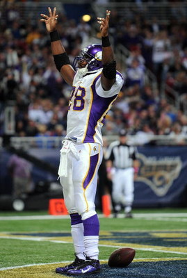 ST. LOUIS - OCTOBER 11:  :  Running back Adrian Peterson #28 of the Minnesota Vikings celebrates his touchdown against the St. Louis Rams at Edward Jones Dome on October 11, 2009 in St. Louis, Missouri.  (Photo by Ronald Martinez/Getty Images)