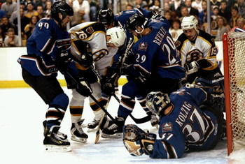 28 Apr 1998:  Tim Taylor #26 of the Boston Bruins fights his way thru Joe Reekie #29 and Joe Juneau #90 of the Washington Capitals during the Bruins 3-0 Eastern Conference playoffs loss at the Fleet Center in Boston, Massachusetts. Mandatory Credit: Craig