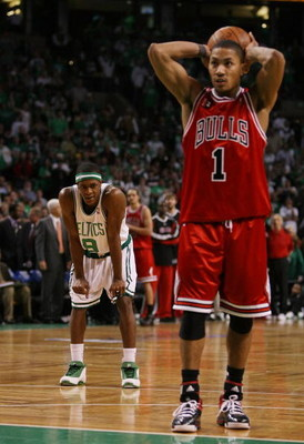 BOSTON - APRIL 18:  Rajon Rondo #9 of the Boston Celtics looks on as Derrick Rose #1 of the Chicago Bulls prepares to shoot a free throw in the final minute of overtime in Game One of the Eastern Conference Quarterfinals during the 2009 NBA Playoffs at TD