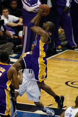 ORLANDO, FL - JUNE 14:  Kobe Bryant #24 of the Los Angeles Lakers goes up for a shot over Courtney Lee #11 of the Orlando Magic in Game Five of the 2009 NBA Finals on June 14, 2009 at Amway Arena in Orlando, Florida.  The Lakers won 99-86.  NOTE TO USER: