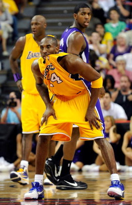 LAS VEGAS - OCTOBER 15:  Kobe Bryant #24 of the Los Angeles Lakers chews on his jersey as he plays defense against the Sacramento Kings during their preseason game at the Thomas & Mack Center October 15, 2009 in Las Vegas, Nevada. NOTE TO USER: User expre