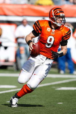 CINCINNATI, OH - OCTOBER 18: Quarterback Carson Palmer #9 of the Cincinnati Bengals runs with the football against the Houston Texans at Paul Brown Stadium on October 18, 2009 in Cincinnati, Ohio. The Texans defeated the Bengals 28-17. (Photo by Scott Boe