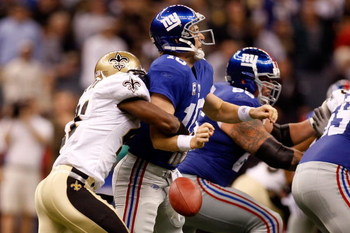 NEW ORLEANS - OCTOBER 18:  Roman Harper #41 of the New Orleans Saints forces a fumble by quarterback Eli Manning #10 of the New York Giants at the Louisiana Superdome on October 18, 2009 in New Orleans, Louisiana.  (Photo by Chris Graythen/Getty Images)