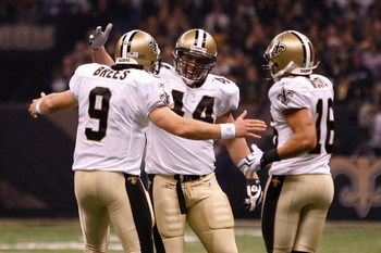 NEW ORLEANS - OCTOBER 18:  Drew Brees #9, Heath Evans #44 and Lance Moore #16 of the New Orleans Saints celebrate after scoring a touchdown against the New York Giants at the Louisiana Superdome on October 18, 2009 in New Orleans, Louisiana.  (Photo by Ch