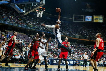 EAST RUTHERFORD, NJ - MAY 04:  Vince Carter #15 of the New Jersey Nets dunks against Chris Bosh #4 of the Toronto Raptors in Game Six of the Eastern Conference Quarterfinals during the 2007 NBA Playoffs on May 4, 2007 at the Continental Airlines Arena at