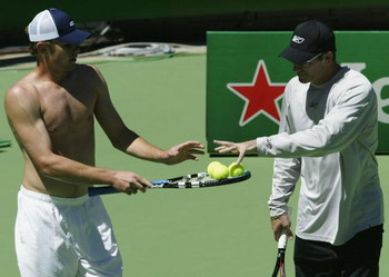 MELBOURNE, AUSTRALIA - JANUARY 15:  Andy Roddick and coach Brad Gilbert of the United States discuss tactics during a training session prior to the 2004 Australian Open at Melbourne Park, January 15, 2004 in Melbourne, Australia. (Photo by Clive Brunskill