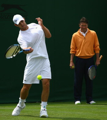 LONDON - JUNE 23:  Andy Roddick of the USA hits a forehand as his coach Jimmy Connors looks on while practicing during previews for the Wimbledon Lawn Tennis Championships at the All England Lawn Tennis and Croquet Club on June 23, 2007 in London, England