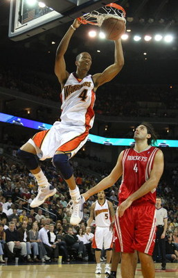 OAKLAND, CA - DECEMBER 12:  Anthony Randolph #4 of the Golden State Warriors shoots over Luis Scola #4 of the Houston Rockets during an NBA game on December 12, 2008 at Oracle Arena in Oakland, California. NOTE TO USER: User expressly acknowledges and agr